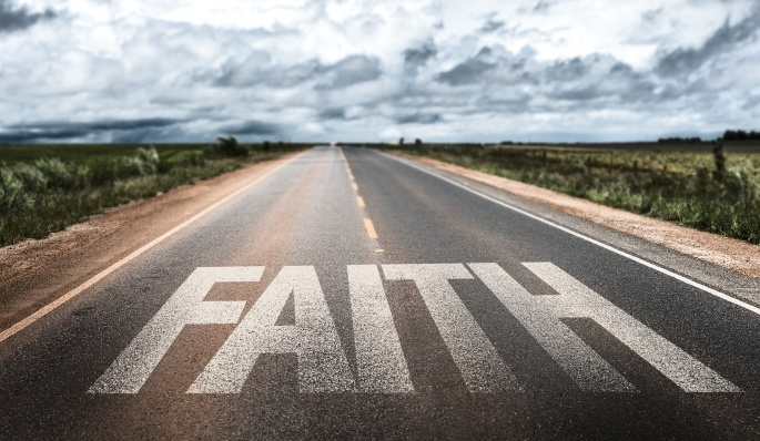 Faith written on rural road